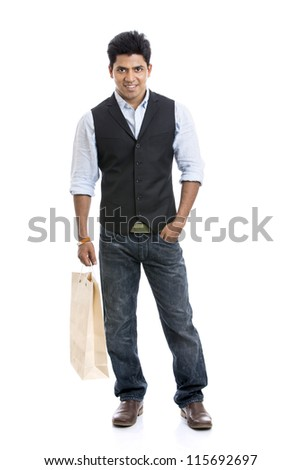Indian young man with shopping bag on white background. - stock photo