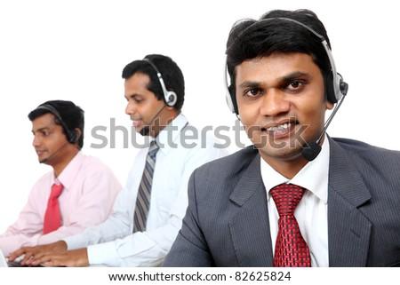 Indian young people working in call center isolated on white. - stock photo