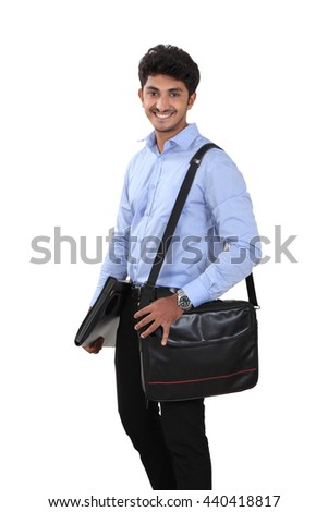 Indian young student carrying file and laptop bag on white. - stock photo