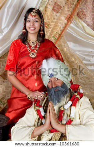 Indian young woman and father with turban - stock photo