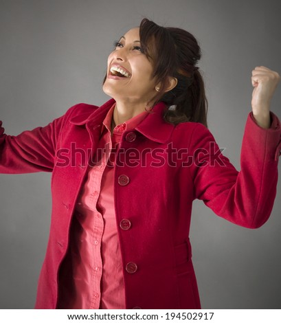 Indian young woman celebrating success - stock photo
