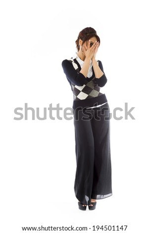 Indian young woman peeking through fingers - stock photo