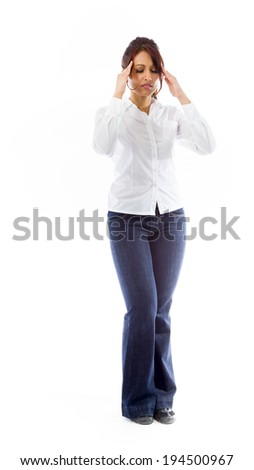 Indian young woman suffering from headache - stock photo