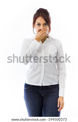 Indian young woman with hand over mouth isolated on white background - stock photo