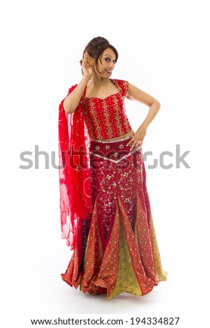 Indian young woman with hand to ear listening isolated over white background - stock photo