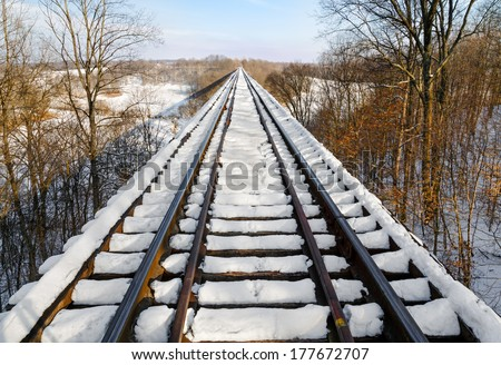 Indiana's Tulip Trestle, one of the world's longest railroad bridges, is covered in snow. - stock photo