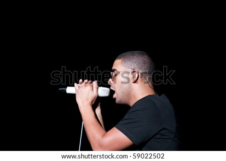 INDIANAPOLIS - AUGUST 13: Hip Hop/ Rap Artist Drake performs on stage at the Indiana State Fair on August 13, 2010 in Indianapolis, Indiana - stock photo