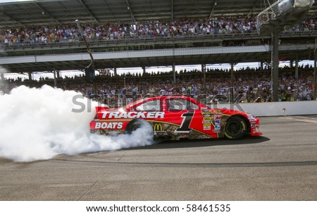 INDIANAPOLIS, IN - JULY 25:  Jamie McMurray does a burn out after winning the Brickyard 400 race at the Indianapolis Motor Speedway on July 25, 2010 in Indianapolis, IN. - stock photo