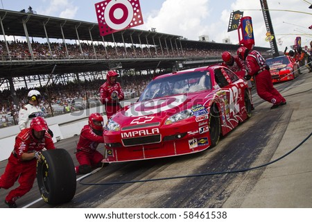 INDIANAPOLIS, IN - JULY 25:  Juan Pablo Montoya makes a pit stop for the Brickyard 400 race at the Indianapolis Motor Speedwayon July 25, 2010 in Indianapolis, IN. - stock photo