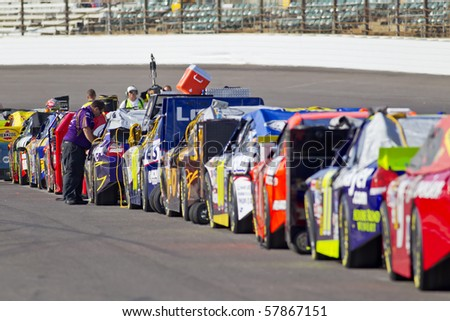 INDIANAPOLIS, IN - JULY 24:  The NASCAR Sprint Cup teams qualify for the Brickyard 400 race at the Indianapolis Motor Speedway on July 24, 2010 in Indianapolis, IN. - stock photo
