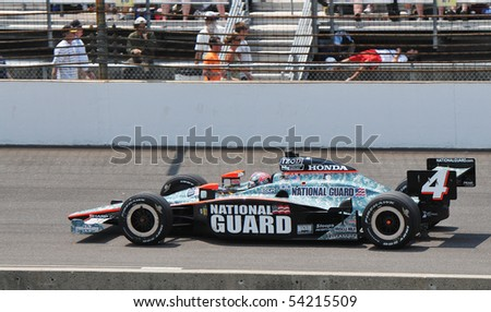 INDIANAPOLIS, IN - MAY 30: Indy car driver dan wheldon is running in the Indy 500 race May 30, 2010 in Indianapolis, IN - stock photo