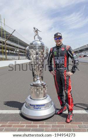 Indianapolis, IN - May 19, 2014:  Kurt Busch (26) poses with the Borg-Warner Trophy before practicing for the Indianapolis 500 IndyCar race in Indianapolis, IN.    - stock photo
