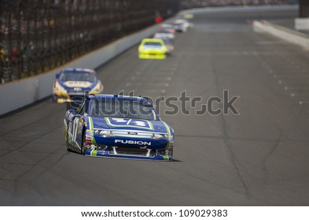 INDIANPOLIS, IN - JUL 29, 2012:  Matt Kenseth (17) brings his car down the front stretch during the Curtiss Shaver race at the Indianapolis Motor Speedway in Indianapolis, IN on 29 Jul, 2012. - stock photo