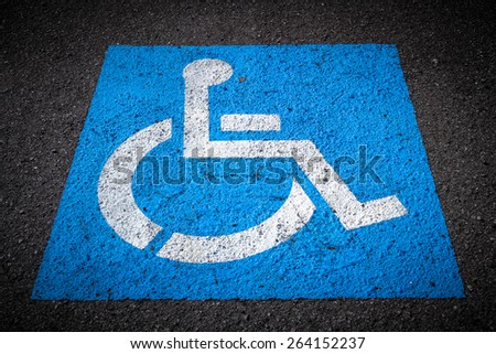 Indication of reserved seat for disabled parking. - stock photo