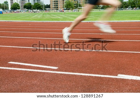 Individual in the lead on the track race showing movement - stock photo