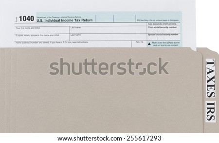 Individual income tax form inside of gray folder. Business financial concept for taxes.  - stock photo