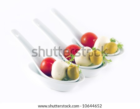 Individual spoons with vegetables and cheese appetizers - stock photo