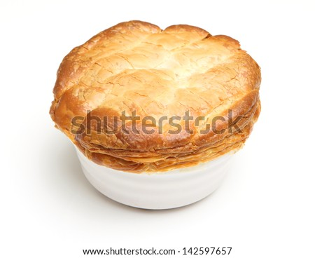 Individual steak pie, fresh out of the oven. - stock photo