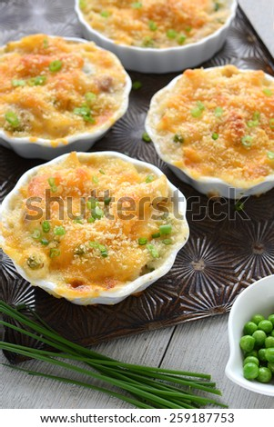 Individual tuna casseroles made with gluten free penne pasta for a healthy meal - stock photo