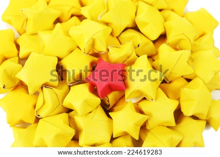 Individuality concept. Origami stars group, close-up - stock photo