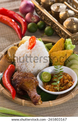 indonesian fried chicken rice  - stock photo