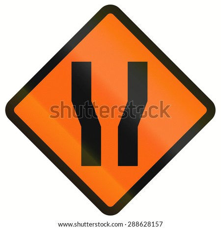 Indonesian temporary road warning sign: Road widens on both sides. - stock photo
