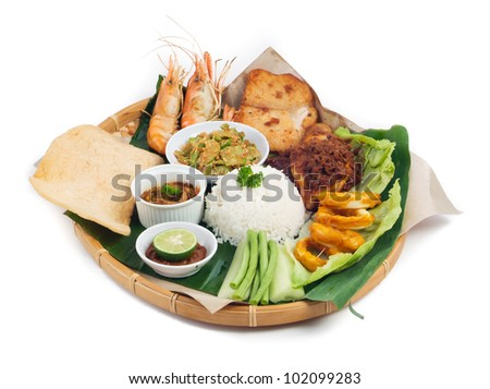 Indonesian traditional food, chicken, fish, vegetables - stock photo