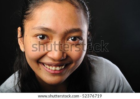 Indonesian Woman photographed on black background - stock photo