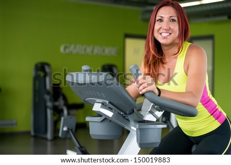 Indoor bicycle cycling in gym - stock photo
