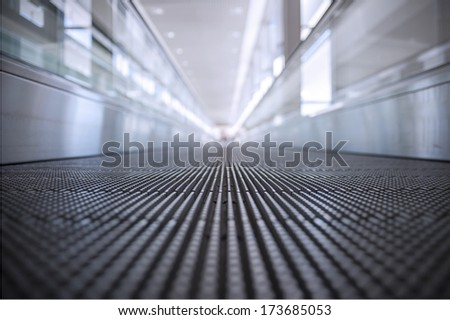 Indoor conveyor belt at airport, abstract detail, shallow dept of field - stock photo