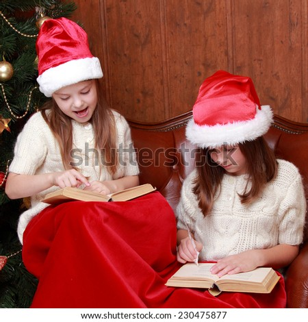 Indoor image of cheerful young girls - stock photo
