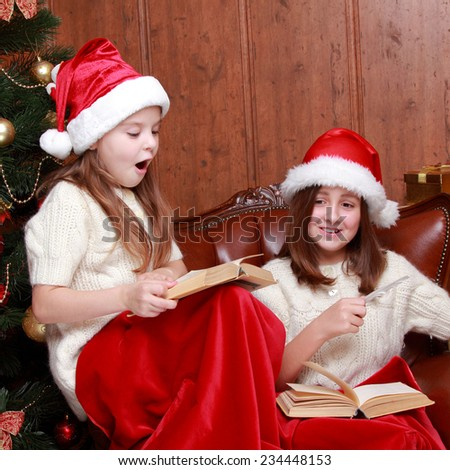 Indoor image of cheerful young girls at Christmas time - stock photo