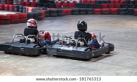 Indoor karting race (2 kart and safety barriers) - stock photo
