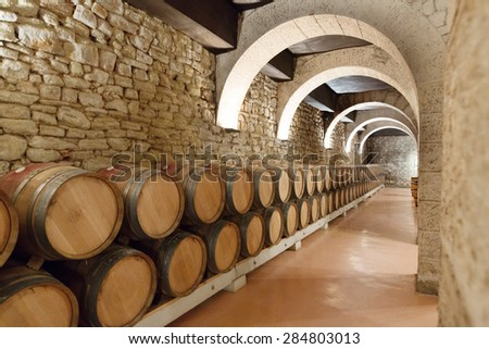 Indoor photo of  wooden barrels in old winery - stock photo