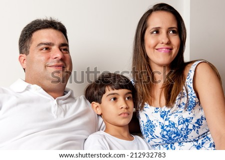 Indoor photo of young family - stock photo