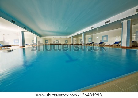 Indoor pool with blue water - stock photo