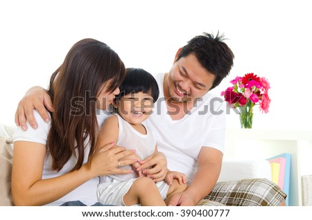 Indoor portrait of asian family in the living room - stock photo