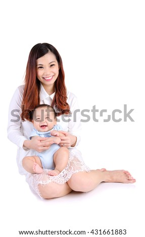 Indoor portrait of asian woman and her cheerful baby - stock photo