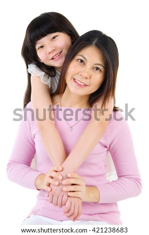 Indoor portrait of beautiful asian mother and daughter isolated on white background - stock photo