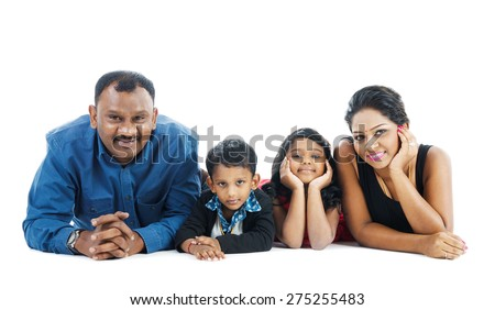 Indoor portrait of indian family - stock photo
