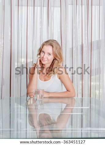indoor portrait of young attractive caucasian woman looking into camera - stock photo