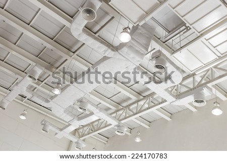 Indoor ventilation system on hight ceiling of large building. - stock photo