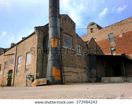 Industrial abandoned brick warehouse exterior view - landscape photo - stock photo