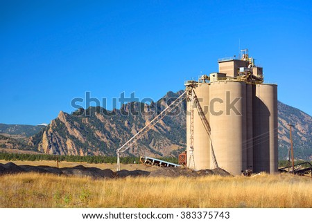 Industrial Agriculture Elevator Silo with Mountains - stock photo