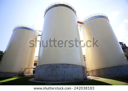 Industrial Agriculture Silo Housing Grain - stock photo