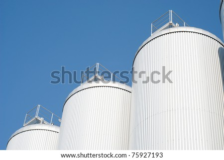 Industrial Agriculture Silo Housing Grain with Copy Space - stock photo