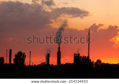 industrial area at sunset - stock photo
