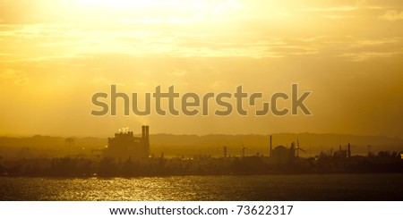 industrial area with heat and haze at dusk - stock photo