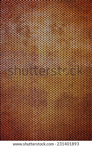 Industrial background of a rusty iron surface perforated with many holes - stock photo