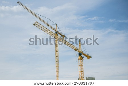 Industrial Background of Cranes at a construction site, in construction of factory - stock photo